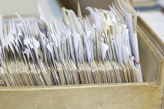 Closeup of open drawer with filing records