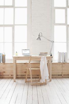 Desk in window area of loft apartment