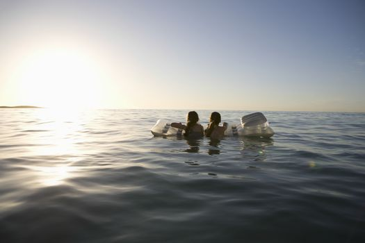 Twin sisters paddle out to sea on air bed