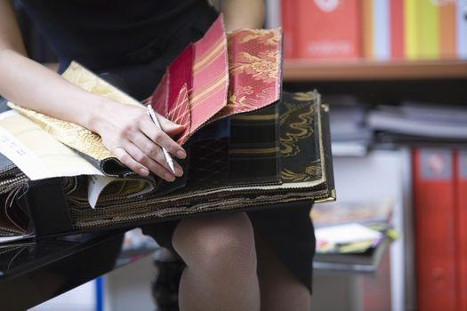 Young designer looks through sample book