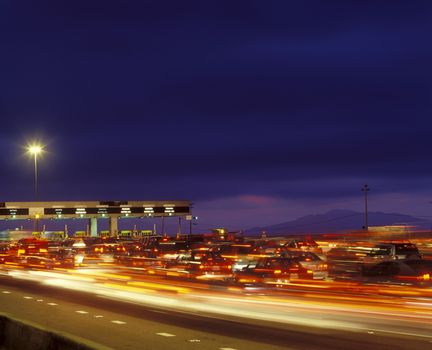 Tail backs of traffic at toll gate in California