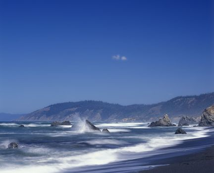 Waves crash against the rocks in Mendocino County California