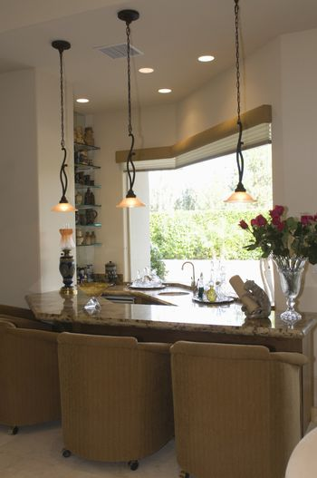 Marble topped kitchen counter with armchairs
