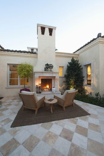 Outdoor room with firepit at dusk