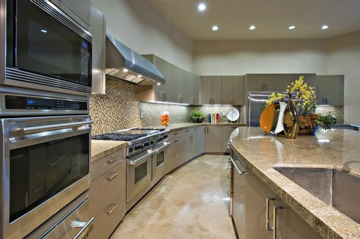 Architecturally designed kitchen with stainless steel fitted units