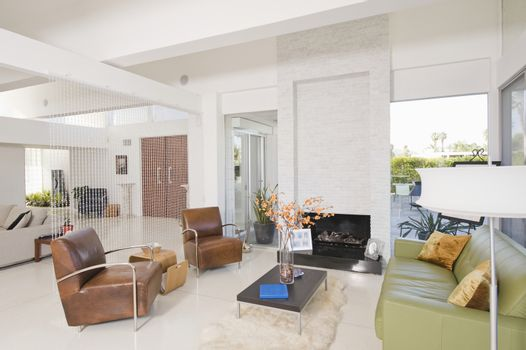 living room with contrasting coloured leather furniture