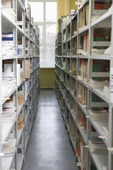 Aisles in university library with shelves full of books