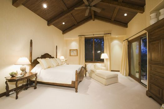 Neutral bedroom with high wooden ceiling