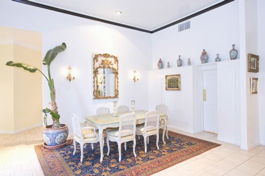 Dining table on patterned rug