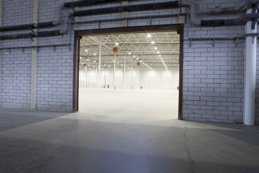 Access door to brightly lit and empty storehouse