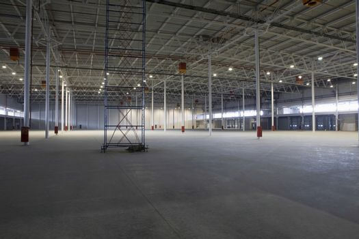 Large empty warehouse with scaffold