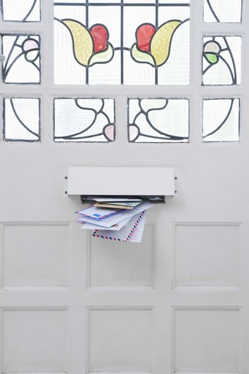 Stream of letters coming through the letter box