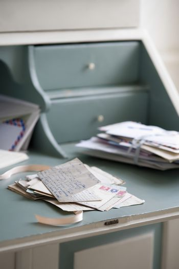 Letters on writing desk at home