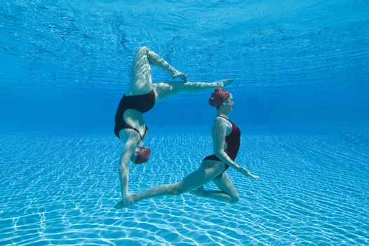 Synchronised swimmers balance underwater
