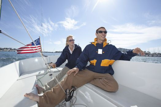 Young couple relax on deck of sailing boat