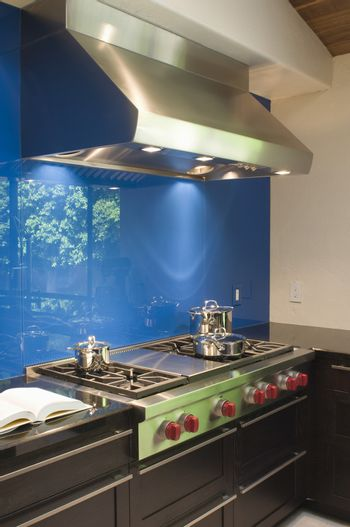 Blue splashback and stainless steel extractor fan