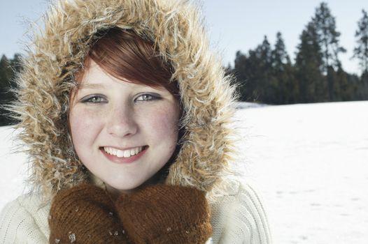 Portrait of teenage girl in hooded jacket