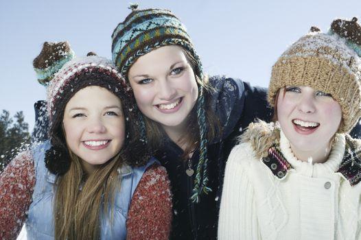 Three girls in winter clothing