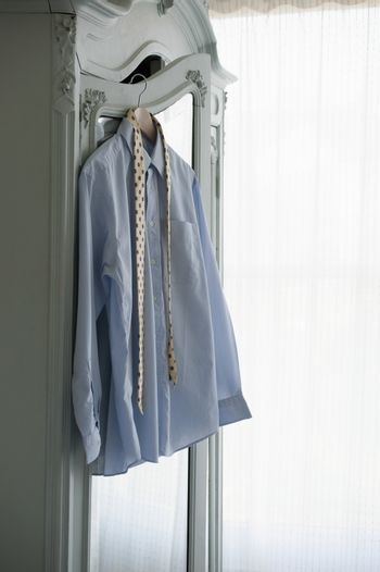 Shirt and tie hanging on wardrobe