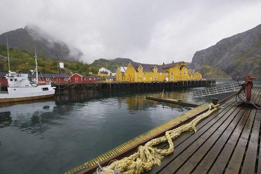 Fishing boat in harbour of Lofoten Islands Norway