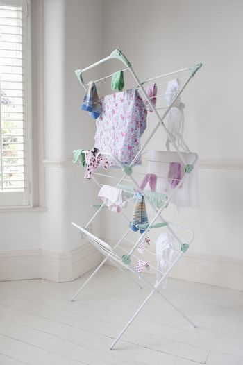 Clothes drying on laundry airer in domestic room