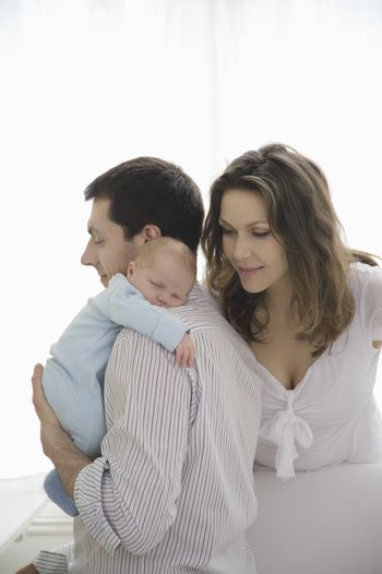 Mother and father with newborn baby
