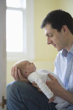 Father holds newborn