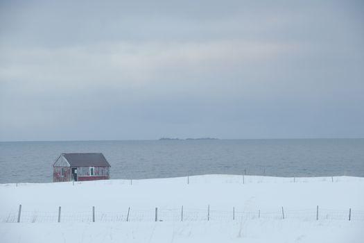 Remote house in coastal landscape Flakstad Flakstadoya  Loftofen Norway