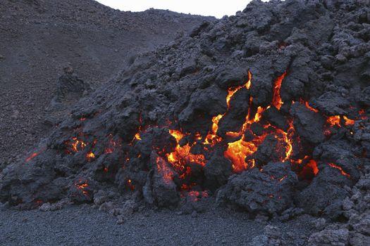 Glowing molten volcanic rock of Eyjafjallajokull Fimmvorduhals Iceland