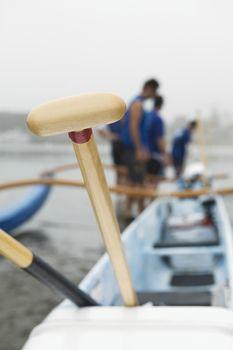 Sea kayak racing team prepare their boat