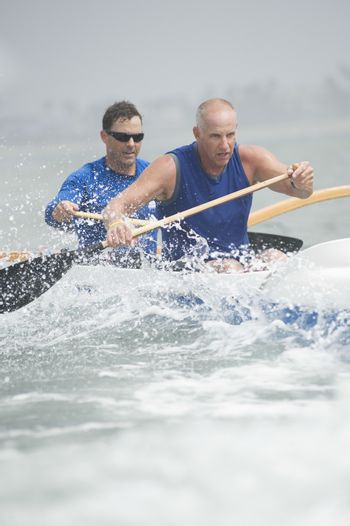 Outrigger canoeing team of two
