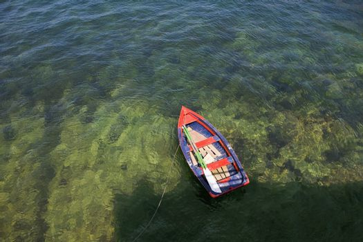 Rowing boat in shallow water Asurias Spain