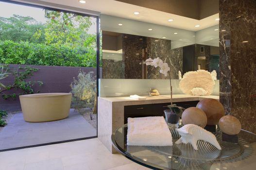 Artwork of freestanding bath in California bathroom