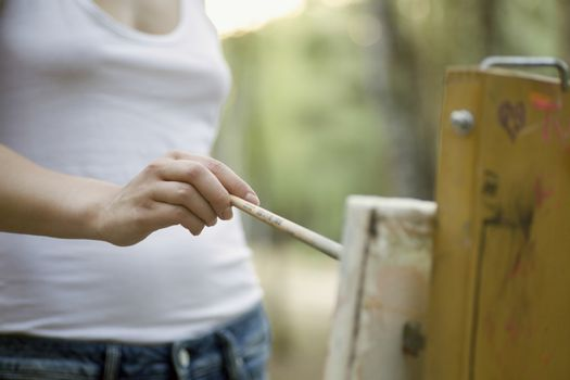 Artists painting on canvas