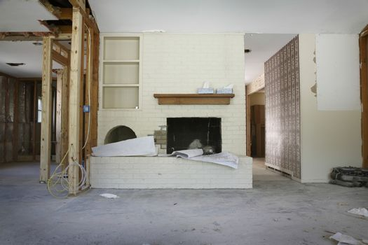 Brick fireplace and shelves in house under renovation