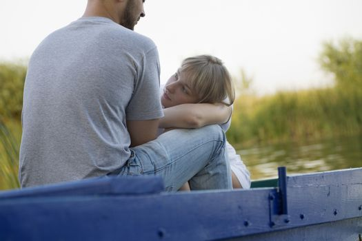 Young couple on blue painted boat Russia