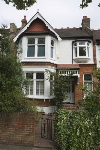 Terraced house with open front gate