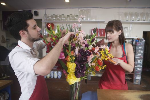 Floriste work on flower arrangement
