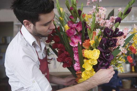 Florist works on flower arrangement