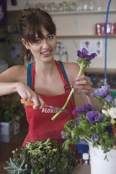Florist cuts stem of flower for arrangement