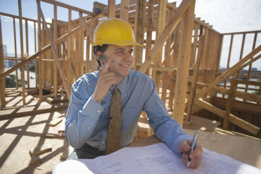 Site manager with building plans