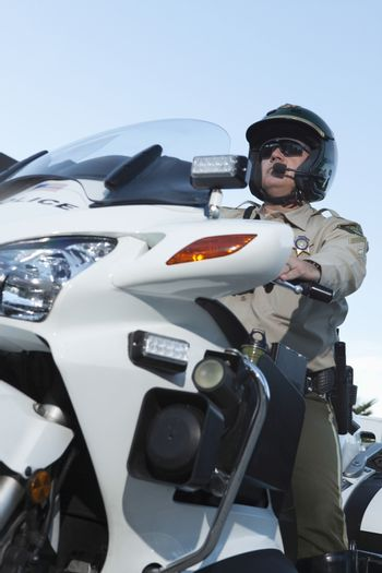 Patrol officer sits on motorcycle