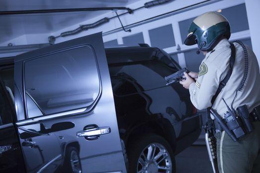 Nightwatch patrolman  stand off with luxury car in garage