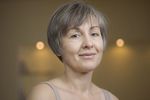 Portrait of mature woman with short grey hair