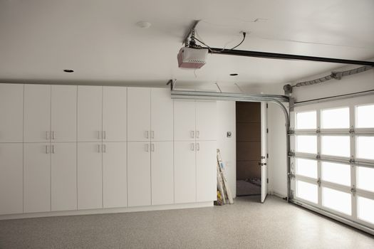 View of empty industrial unit with storage cabinets