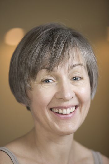 Portrait of mature woman with short grey hair  laughing