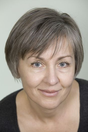 Mature woman with short grey hair