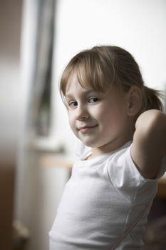 Portrait of girl  hands behind head