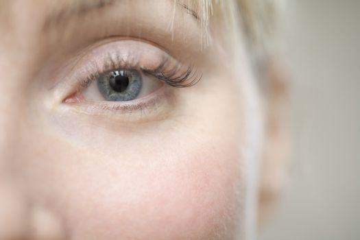 Part of a young womans face showing her eye