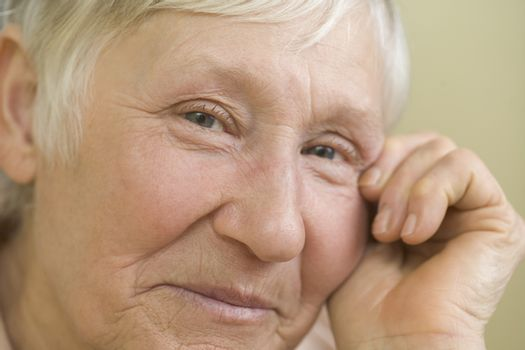 Elderly woman with short grey hair  smiling